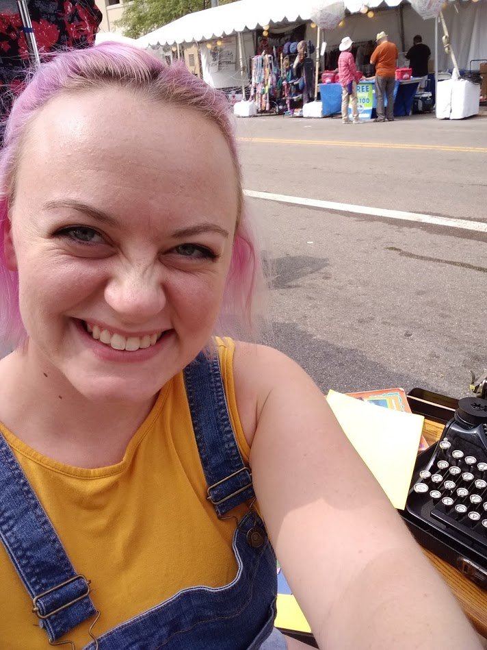 Writing poems on my typewriter at a festival