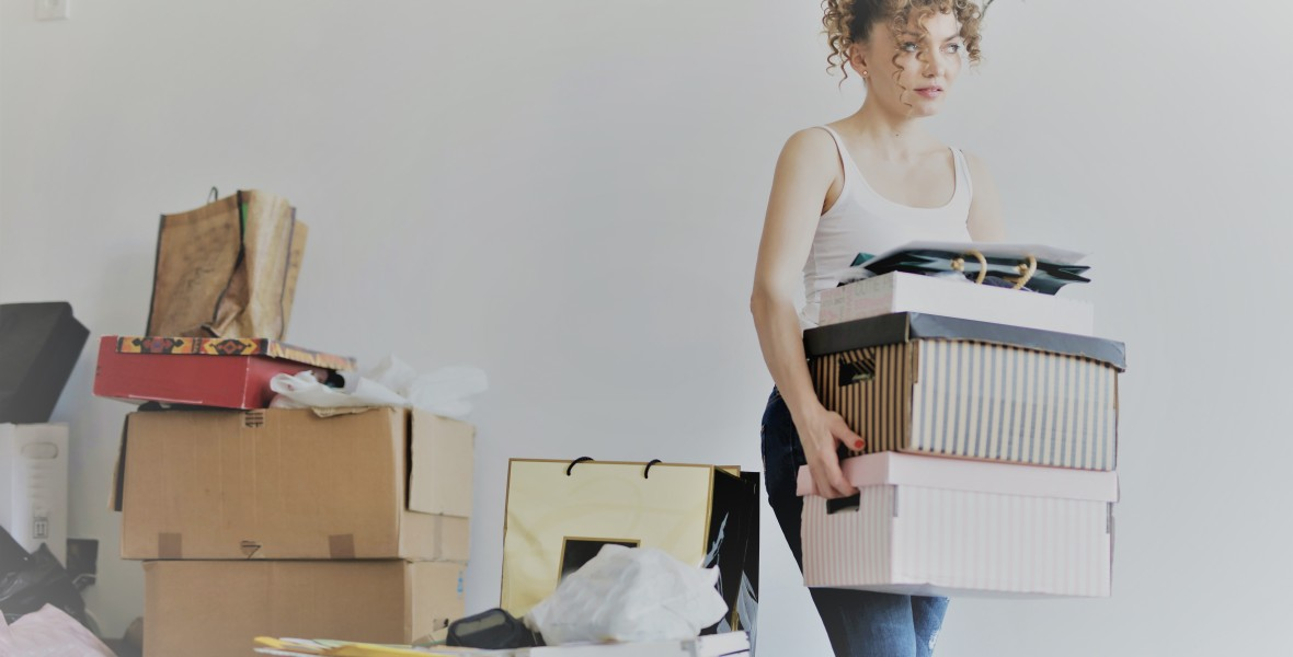 Woman carrying boxes doing junebugging cleaning